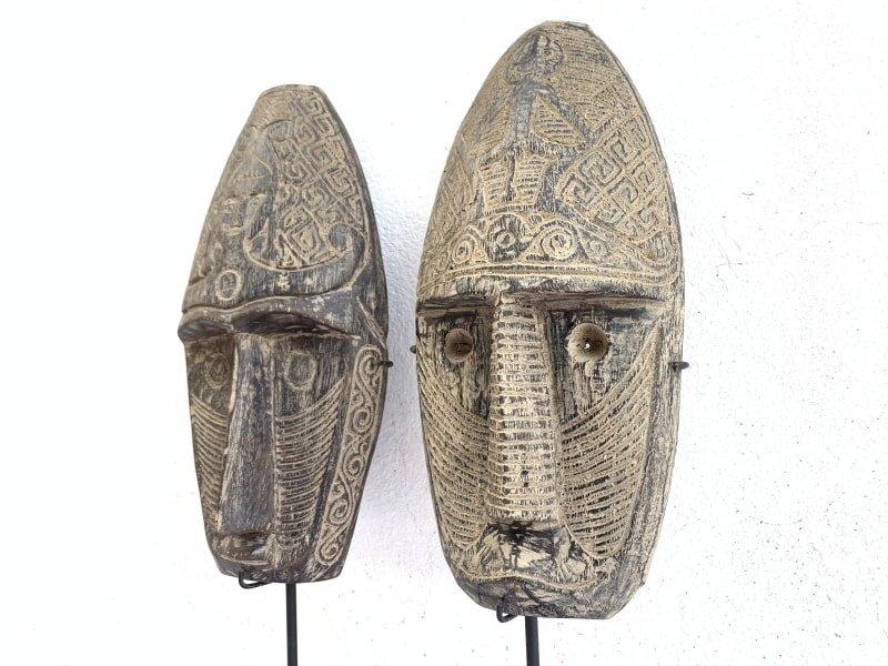 TWOTRIBALMASK.ONSTANDNiasFaceSculptureFigureStatueSouthEastAsia